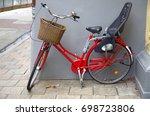 vintage red basket with bike. | Shutterstock . vector #698723806