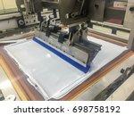 silkscreen white ink machine is ... | Shutterstock . vector #698758192