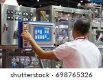 factory engineer controlling... | Shutterstock . vector #698765326