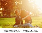 a loving couple of teenagers.... | Shutterstock . vector #698765806