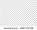 black polka dots on white... | Shutterstock . vector #698776708