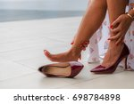 woman sore legs while shopping... | Shutterstock . vector #698784898