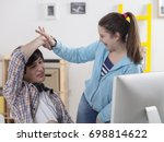 two teenager at the desk ... | Shutterstock . vector #698814622