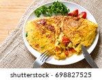 spanish omelete. egg dishes. | Shutterstock . vector #698827525