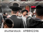 Small photo of The Jewish Hasid in traditional clothes with long payos.