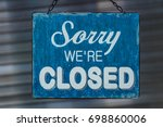 closed for business sign  on... | Shutterstock . vector #698860006