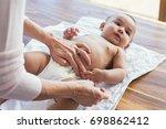 mother hands changing baby... | Shutterstock . vector #698862412