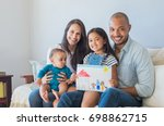 daughter showing drawing of a... | Shutterstock . vector #698862715