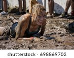 young woman crawling in the mud ... | Shutterstock . vector #698869702