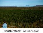 girl traveler in front of the...   Shutterstock . vector #698878462