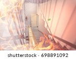 fire in the office building | Shutterstock . vector #698891092