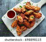 baked chicken wings with sesame ... | Shutterstock . vector #698898115