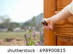 women hand open door knob or... | Shutterstock . vector #698900815