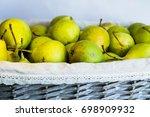 green pears in a wicker basket | Shutterstock . vector #698909932