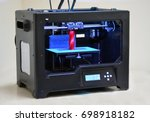3d printer works and creates an ... | Shutterstock . vector #698918182