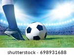 soccer ball with feet player on ... | Shutterstock . vector #698931688