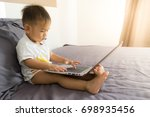asian baby hands are typing on... | Shutterstock . vector #698935456