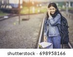 asian girl wearing jeans and a... | Shutterstock . vector #698958166