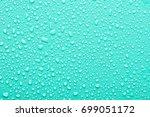 water drops on a green... | Shutterstock . vector #699051172