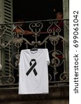 Small photo of BARCELONA/SPAIN - 19 AGOSTO 2017: T shirts with black ribbon exposed on windows of Rambla, two days after the terrorist attack in Barcelona. Credit:Dino Geromella