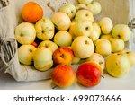 fresh harvest of apples in a... | Shutterstock . vector #699073666