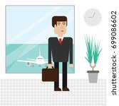 business man at the airport is... | Shutterstock .eps vector #699086602