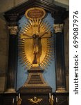 Small photo of COLOGNE, GERMANY - SEP 15, 2016 - Golden crucifix on altar in St Peter's Cathedral, Cologne, Germany