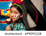 girl with painted face  eating... | Shutterstock . vector #699092128
