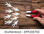 closeup of magnet attracting... | Shutterstock . vector #699106702