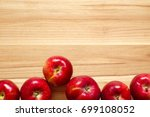 apples on wood.top down view... | Shutterstock . vector #699108052