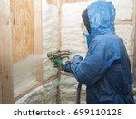 a man applies an insulating... | Shutterstock . vector #699110128