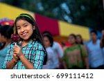 girl watching camera holding an ...   Shutterstock . vector #699111412