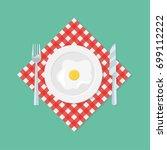 scrambled egg on plate  fork... | Shutterstock .eps vector #699112222