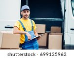 workman or courier holds carton ...   Shutterstock . vector #699125962