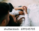 a couple of newlyweds are... | Shutterstock . vector #699145705