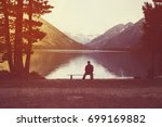 young man sitting on bench... | Shutterstock . vector #699169882