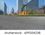 empty road and modern office... | Shutterstock . vector #699204238