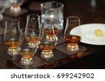 whiskey tasting  whiskey glass | Shutterstock . vector #699242902