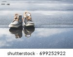 little kids laced shoes close... | Shutterstock . vector #699252922
