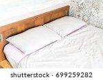 pillow on bed decoration in... | Shutterstock . vector #699259282