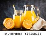 jar of orange juice   Shutterstock . vector #699268186