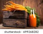 fresh organic carrot juice   Shutterstock . vector #699268282