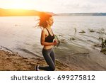 a beautiful sporty woman runing ... | Shutterstock . vector #699275812