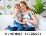 girl expecting a sister | Shutterstock . vector #699280396