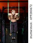 intense workout in dark gym ... | Shutterstock . vector #699283672