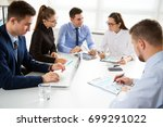 group of business people at a... | Shutterstock . vector #699291022