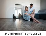 young parents giving lots of... | Shutterstock . vector #699316525