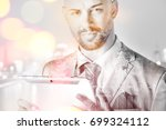 young manager with tablet pc... | Shutterstock . vector #699324112