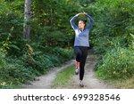 white female fitness model... | Shutterstock . vector #699328546