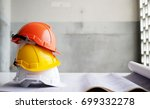Hard safety helmet hat for safety project of workman as engineer or worker on concrete floor. - stock photo